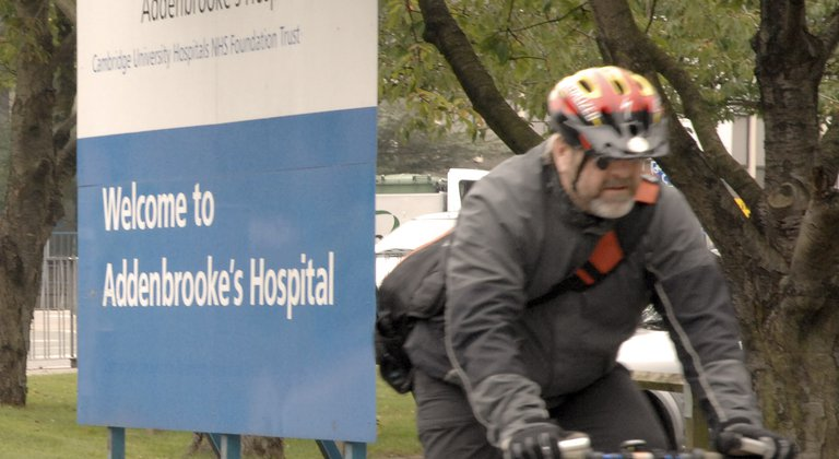 Cyclist by the Addenbrooke's sign