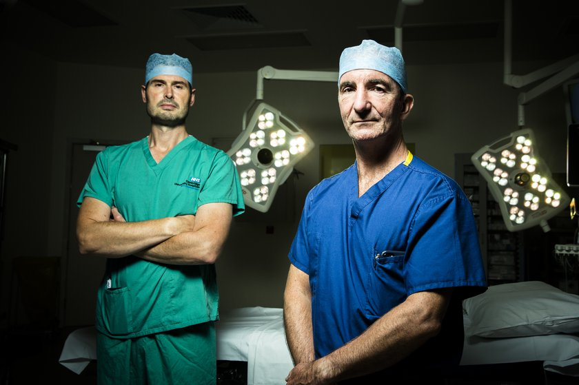 Mr Andrew Carrothers from Addenbrooke's and Mr David Jenkins standing together in an operating theatre
