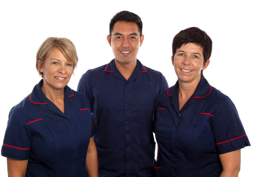 Group picture of three stoma care nurses