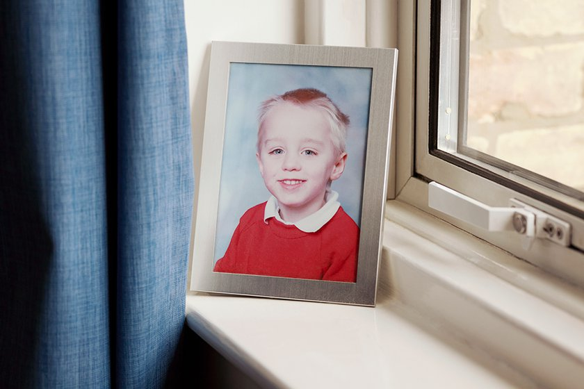 Baby Alex framed picture on a window sill