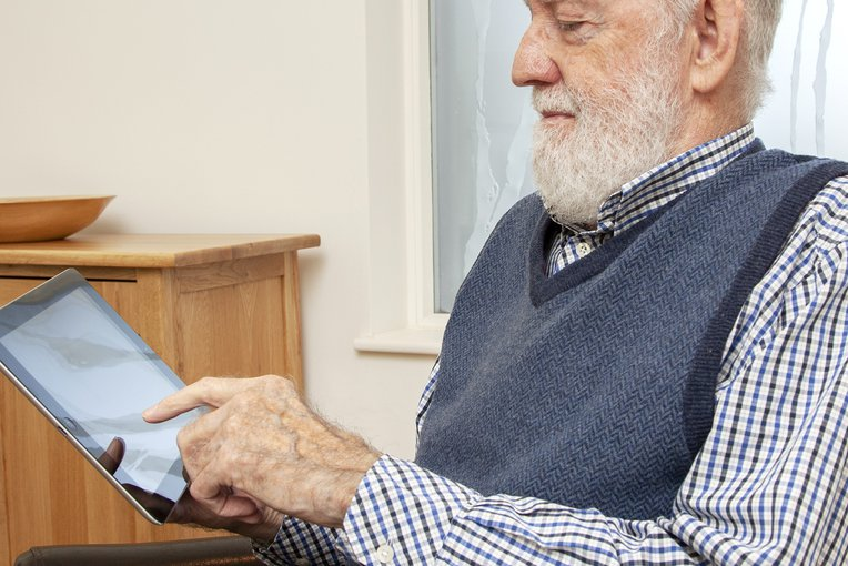 A patient using an iPad for MyChart, our patient portal