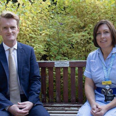 Alex Reid and Tanya Morgan sitting on a bench in Jubilee Garden