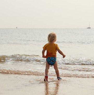 Max walking into the sea
