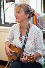 Photograph of a woman playing the ukulele