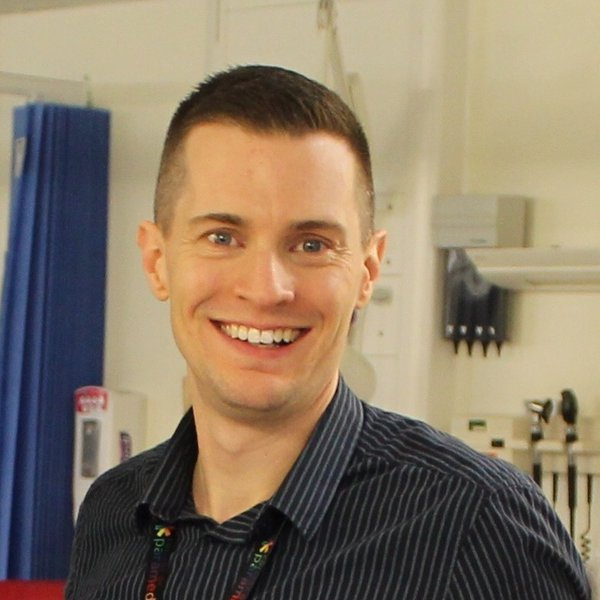 Head shot of David Monk, Urgent care programme lead, smiling at the camera.
