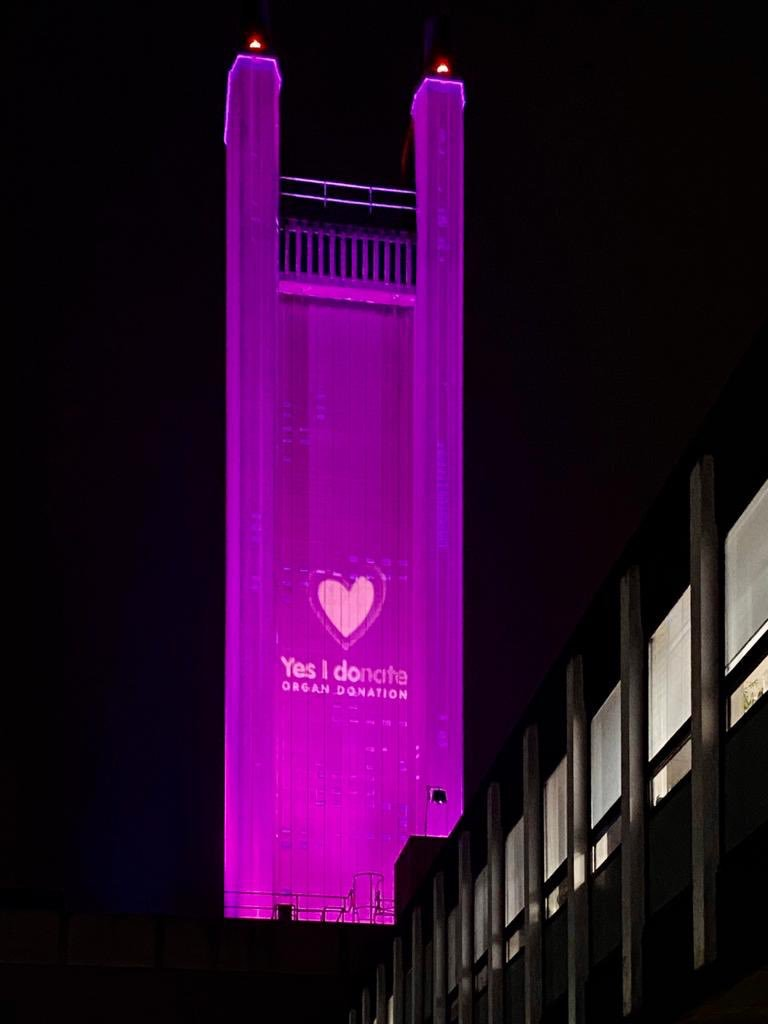 Addenbrooke's chimney lit up with the 'Yes I donate' slogan for Organ Donation Week