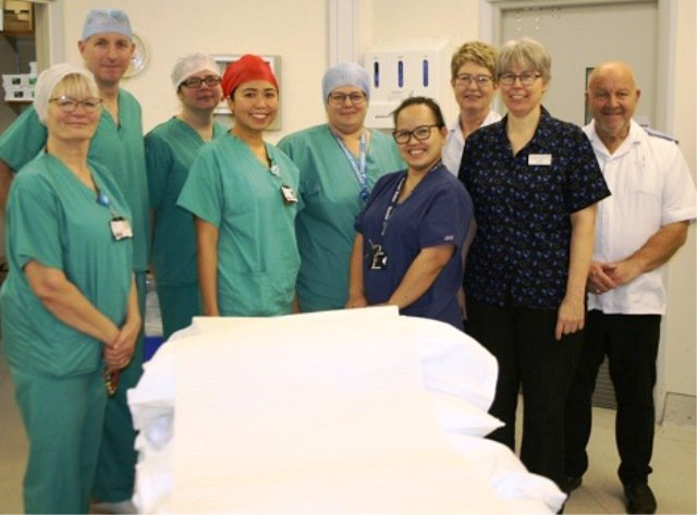 A group of staff at Ely day surgery unit are standing together smiling at the camera