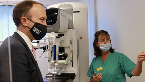 Director of breast screening Kathryn Taylor demonstrates the new 3D mammography technology to Matt Hancock