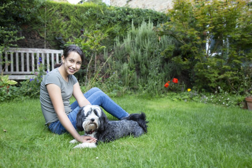 Jasmine playing with her dog in the garden