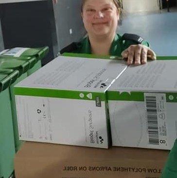 St John Ambulance Volunteer Mel Godefroy with boxes of PPE