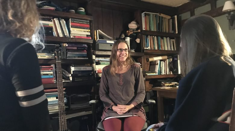 Prof Tamsin Ford sitting in a room surrounded by books