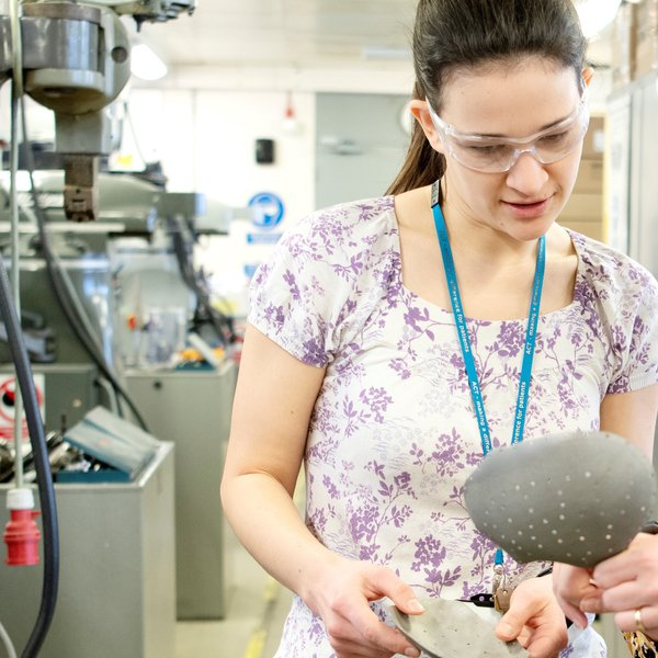 Head and shoulders picture of clinical engineer Rachel Andrews looking at a piece of equipment