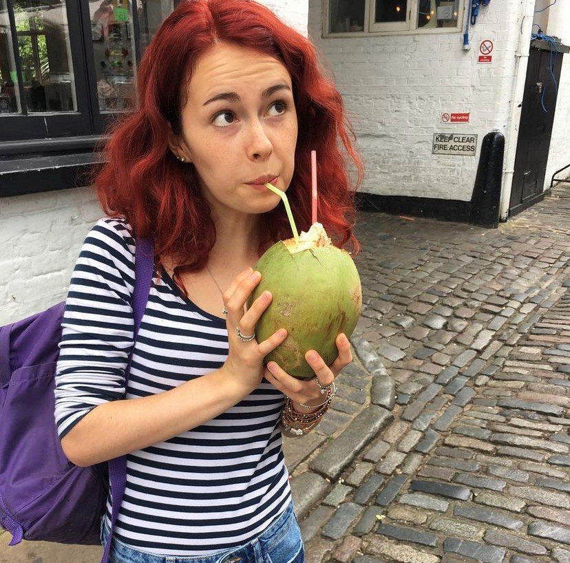 Sky drinking from a coconut through a straw