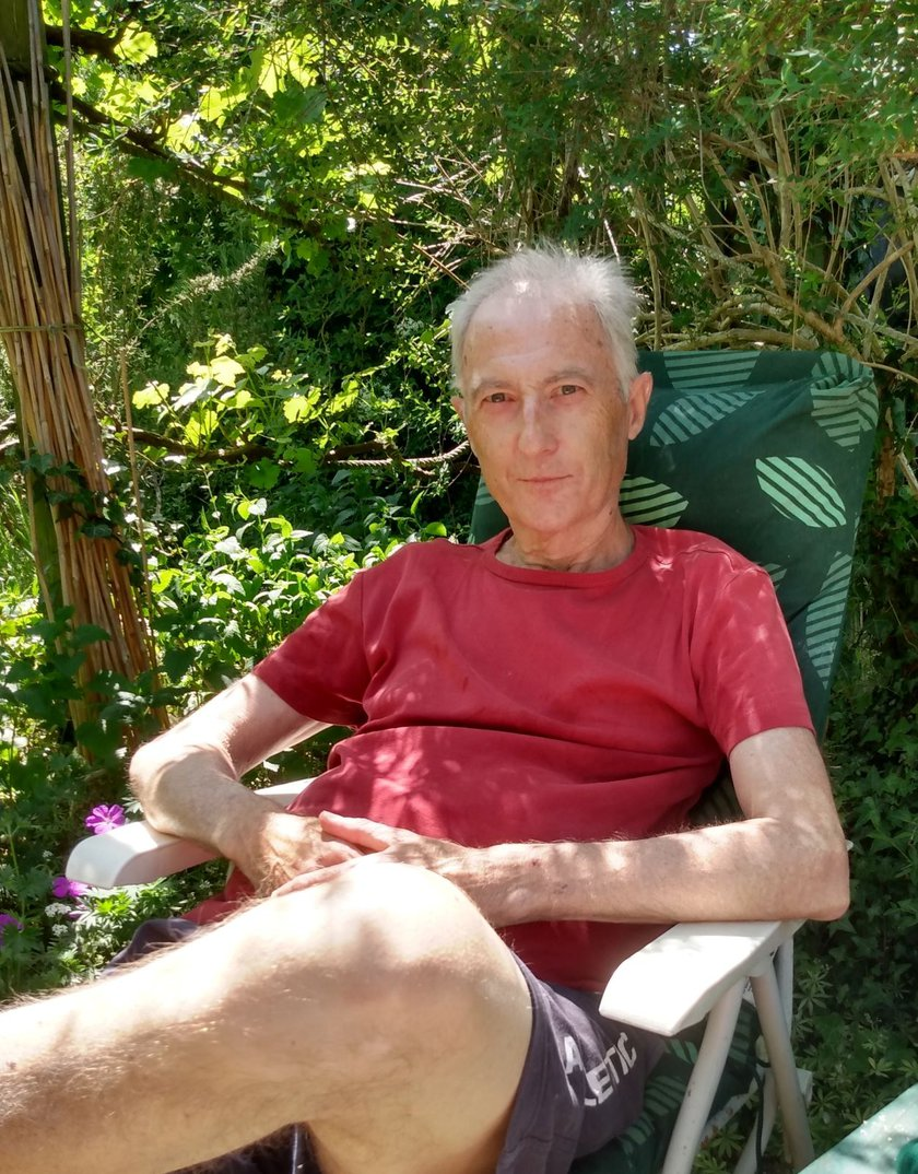 A patient Stephen Cooper sitting in a garden chair
