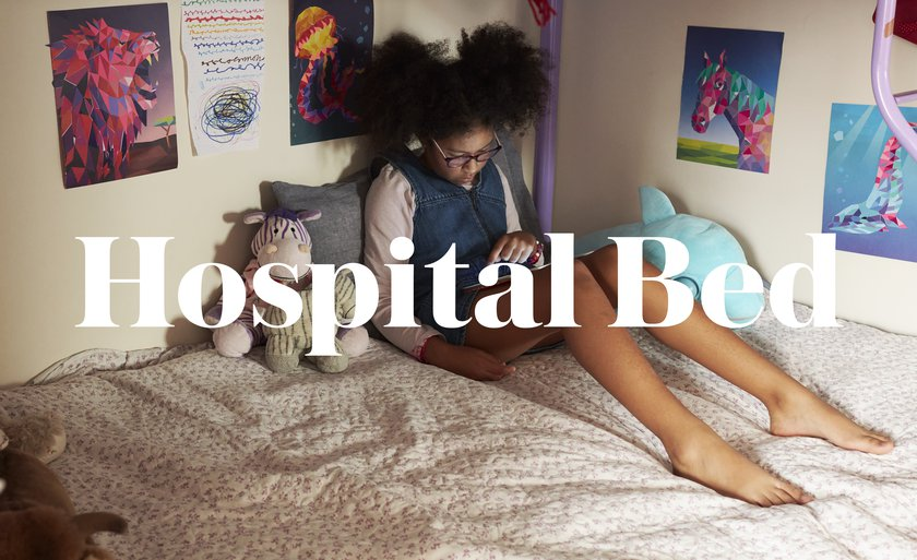 A subversive image showing a child on her bed at home overlaid with the words Hospital Bed