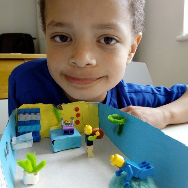 Marley, age 7, with a model of his ideal hospital bedroom