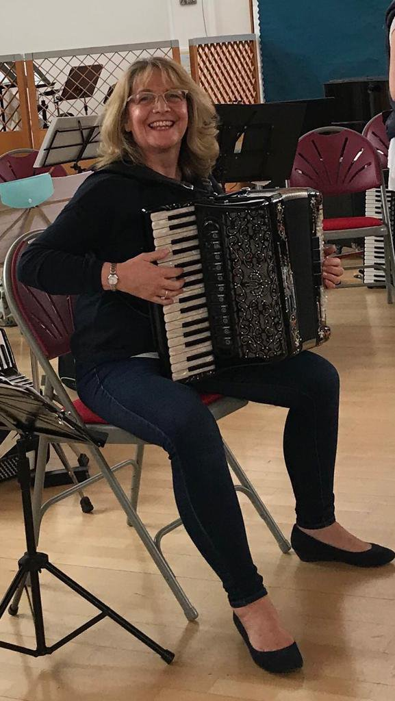 Photograph of a woman playing the accordion