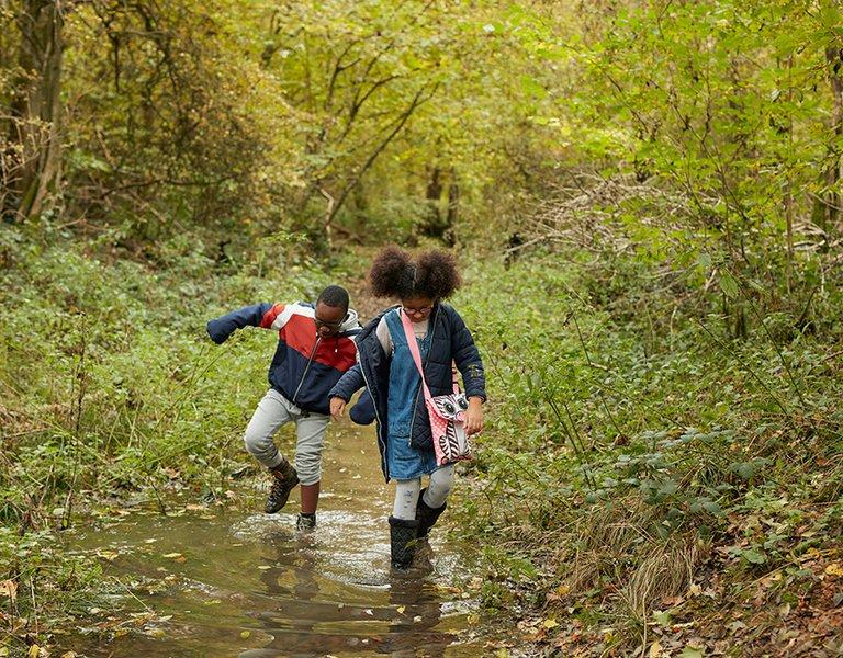 Zofeya playing in woods with siblings