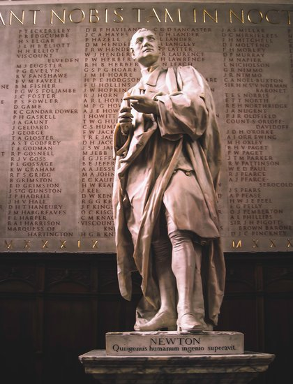 A marble statue of Sir Isaac Newton, natural philosopher, mathematician, and scientist