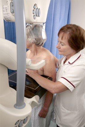 Radiographer taking a mammogram