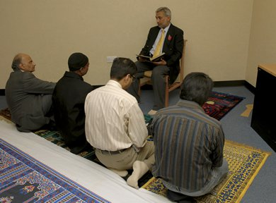 A group of Muslim men praying together