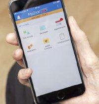Hand holding smartphone showing MyChart patient portal.