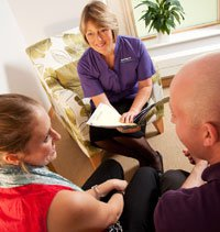 Couple having a consultation with Cambridge IVF nurse