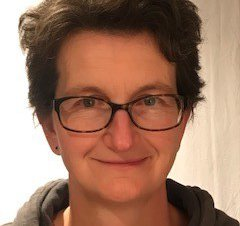 Headshot of Dr Elinor Moore