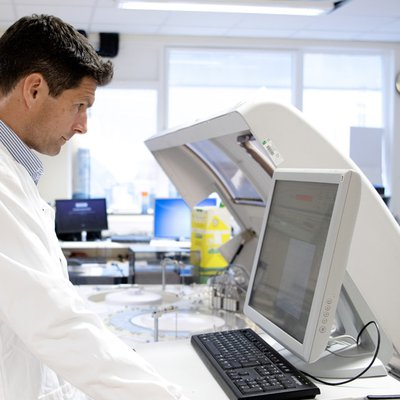 Researcher using computer in a research facility