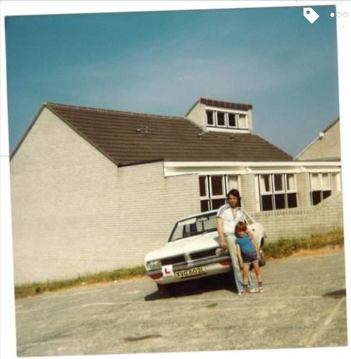 Photograph: Richard (as a child) and his father in front of their car and house.