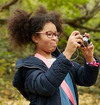 Zofeya holding camera and playing outdoor